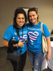 Three-year breast cancer survivor and First American employee, Stephanie Hathaway (right), poses with a volunteer at the Komen OC phone-a-thon held in Irvine.