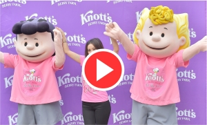 Brenda Song holding hands with Peanuts characters Lucy and Frieda