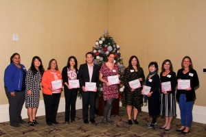 2018 Komen OC grant recipients. From L to R: Komen's Director of Mission Services Ambrocia Lopez; Komen Board member Dr. January Lopez; YMCA of North Orange County Past President Rosamaria Gomez-Amaro; Vietnamese American Cancer Foundation Executive Director Becky Nguyen; The Cambodian Family Community Center Executive Director Vattana Peong; Share Ourselves Nurse Clinic Manager Kristin Almieri; Planned Parenthood of Orange and San Bernardino Counties Vice President of Development Laurie Rayner; Nhan Hoa Comprehensive Health Care Clinic Boardmember Duc Vuong; AltaMed Health Services Nurse Practitioner Deborah Binning; and at Breast Cancer Solutions Executive Director Jennifer Anderson.